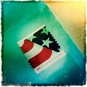 usa-stamp-on-blue-envelope